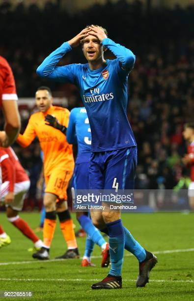 Per Mertesacker of Arsenal reacts after conceding the fourth goal during the Emirates FA Cup Third Round match between Nottingham Forest and Arsenal...