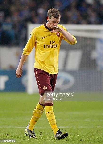 Per Mertesacker of Arsenal reacts after the UEFA Champions League group B match between FC Schalke 04 and Arsenal FC at VeltinsArena on November 6...