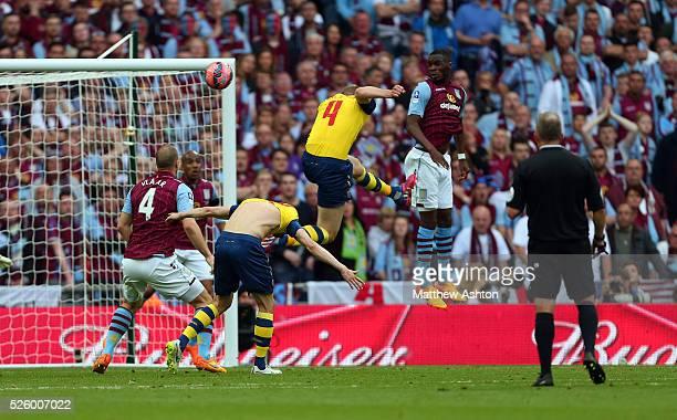 Per Mertesacker of Arsenal scores a goal to make it 03