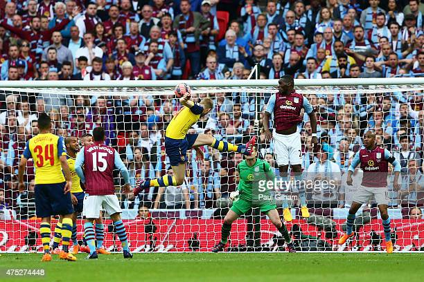 Per Mertesacker of Arsenal scores their third goal during the FA Cup Final between Aston Villa and Arsenal at Wembley Stadium on May 30 2015 in...