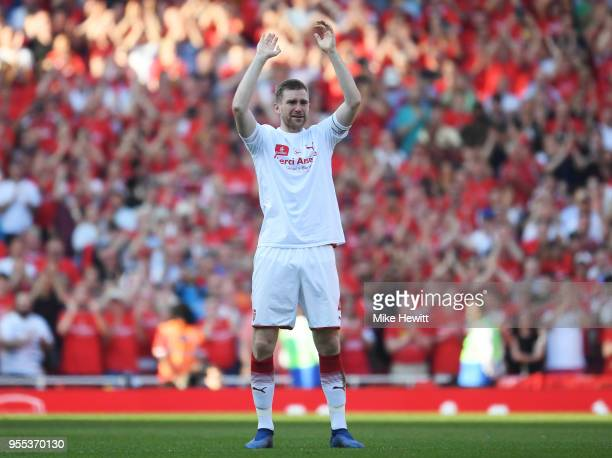 Per Mertesacker of Arsenal shows appreciation to the fans after the Premier League match between Arsenal and Burnley at Emirates Stadium on May 6...