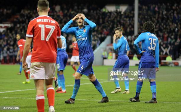 Per Mertesacker of Arsenal shows his disbelief as Kevin Dowell of Nottingham Forest penalty is allowed to stand during The Emirates FA Cup Third...