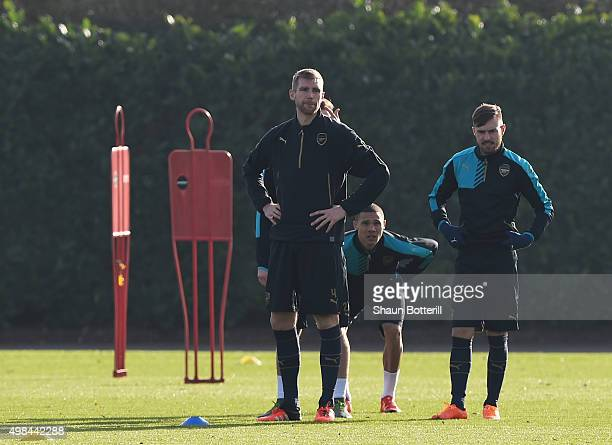 Per Mertesacker of Arsenal warmsup during a training session at London Colney on November 23 2015 in St Albans United Kingdom