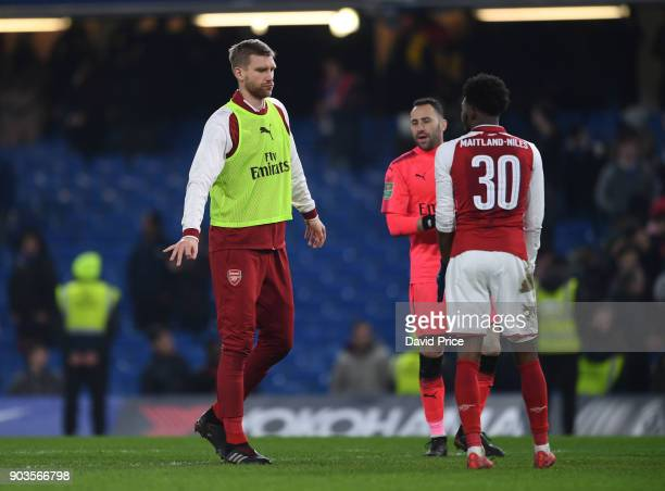 Per Mertesacker of Arsenal with Ainsley MaitlandNiles after the Carabao Cup Semi Final 1st leg match between Chelsea and Arsenal at Stamford Bridge...