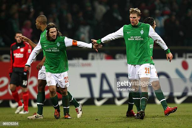 Per Mertesacker of Bremen celebrates after he scores his team's 2nd goal during the Bundesliga match between Werder Bremen and Bayer Leverkusen at...