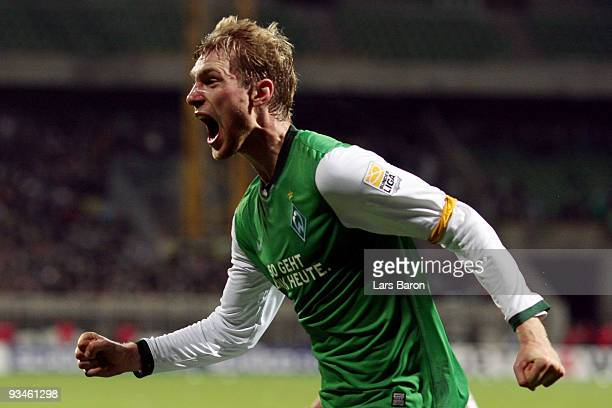 Per Mertesacker of Bremen celebrates after scoring his teams second goal during the Bundesliga match between SV Werder Bremen and VfL Wolfsburg at...