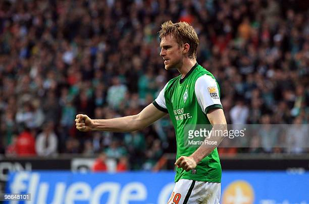 Per Mertesacker of Bremen celebrates during the Bundesliga match between Werder Bremen and 1. FC Koeln at Weser Stadium on April 24, 2010 in Bremen,...