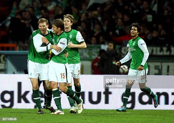 Per Mertesacker of Bremen celebrates with his team mates his team's 2nd goal during the UEFA Europa League Group L match between Werder Bremen and CD...