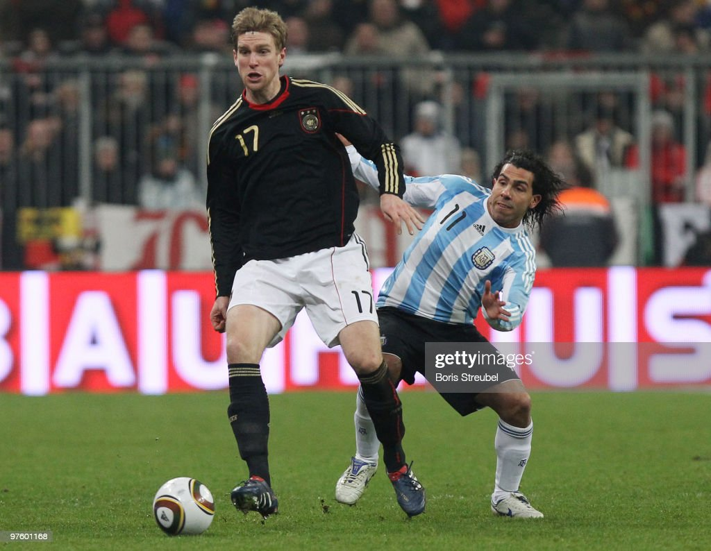 Per Mertesacker (L) of Germany battles for the ball with Carlos Tevez (R) of Argentina during the International Friendly match between Germany and Argentina at the Allianz Arena on March 3, 2010 in Munich, Germany.