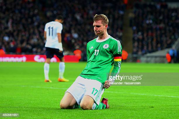 Per Mertesacker of Germany celebrates as he scores their first goal during the international friendly match between England and Germany at Wembley...