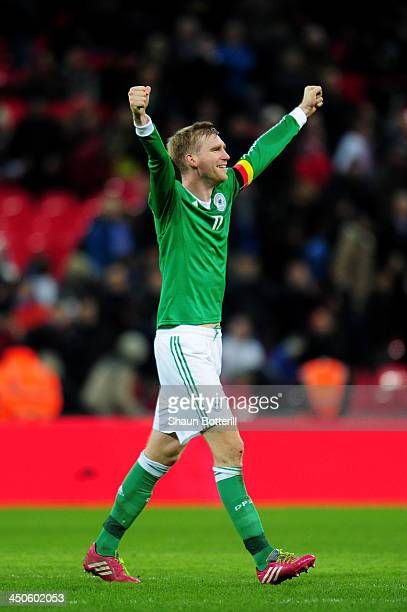 Per Mertesacker of Germany celebrates his team's 10 victory during the international friendly match between England and Germany at Wembley Stadium on...