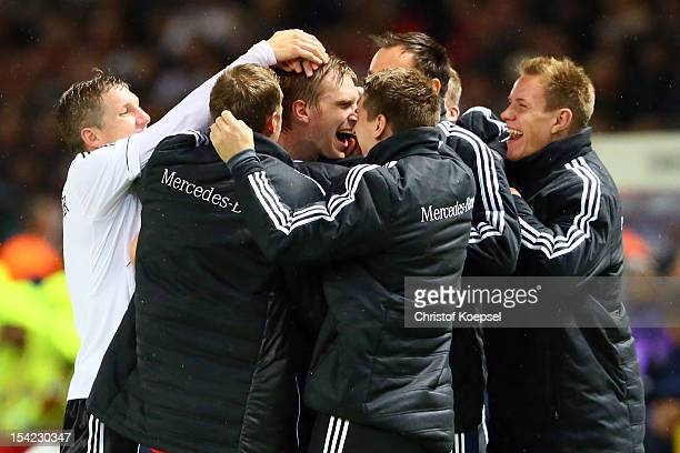 Per Mertesacker of Germany celebrates the third goal with his team mates during the FIFA 2014 World Cup qualifier group C match between German and...