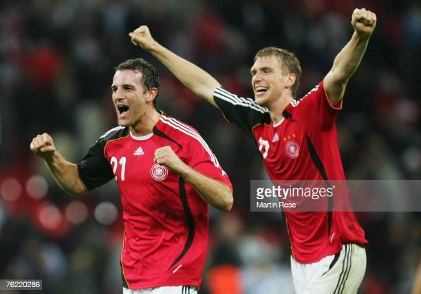 Per Mertesacker of Germany celebrates with teammate Christoph Metzelder as the final whistle blows during the international friendly match between...