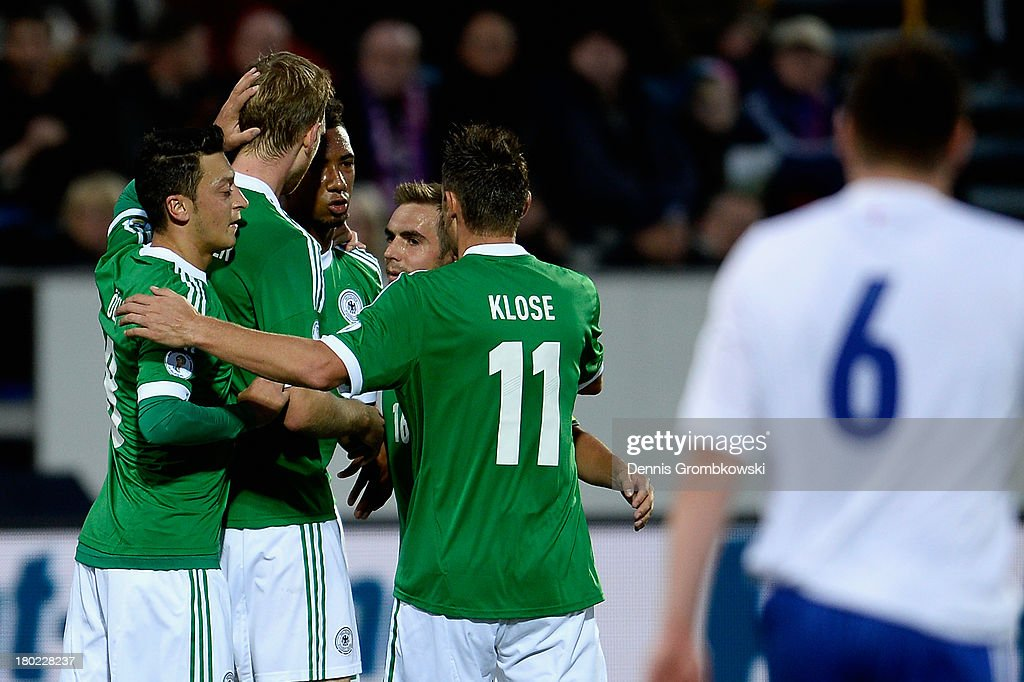 Per Mertesacker of Germany celebrates with teammates after scoring his team's first goal during the FIFA 2014 World Cup Qualifier match between Faeroe Islands and Germany on September 10, 2013 in Torshavn, Denmark.