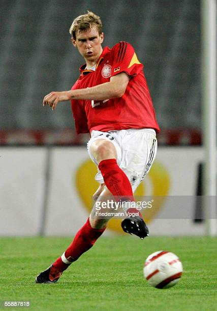 Per Mertesacker of Germany in action during the friendly match between Turkey and Germany at the Ataturk Olympic Stadium on October 8 2005 in...