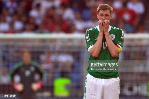 Per Mertesacker of Germany reacts during the international friendly match between Switzerland and Germany at St. Jakob-Park on May 26, 2012 in Basel,...