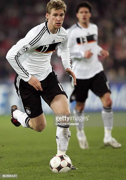Per Mertesacker of Germany runs with the ball during the international friendly match between Switzerland and Germany at the St JakobPark on March 26...