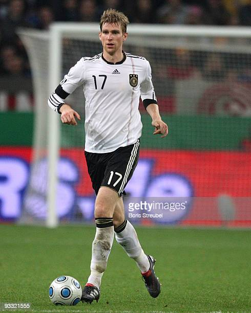 Per Mertesacker of Germany runs with the ball during the International Friendly match between Germany and Ivory Coast at the Schalke Arena on...