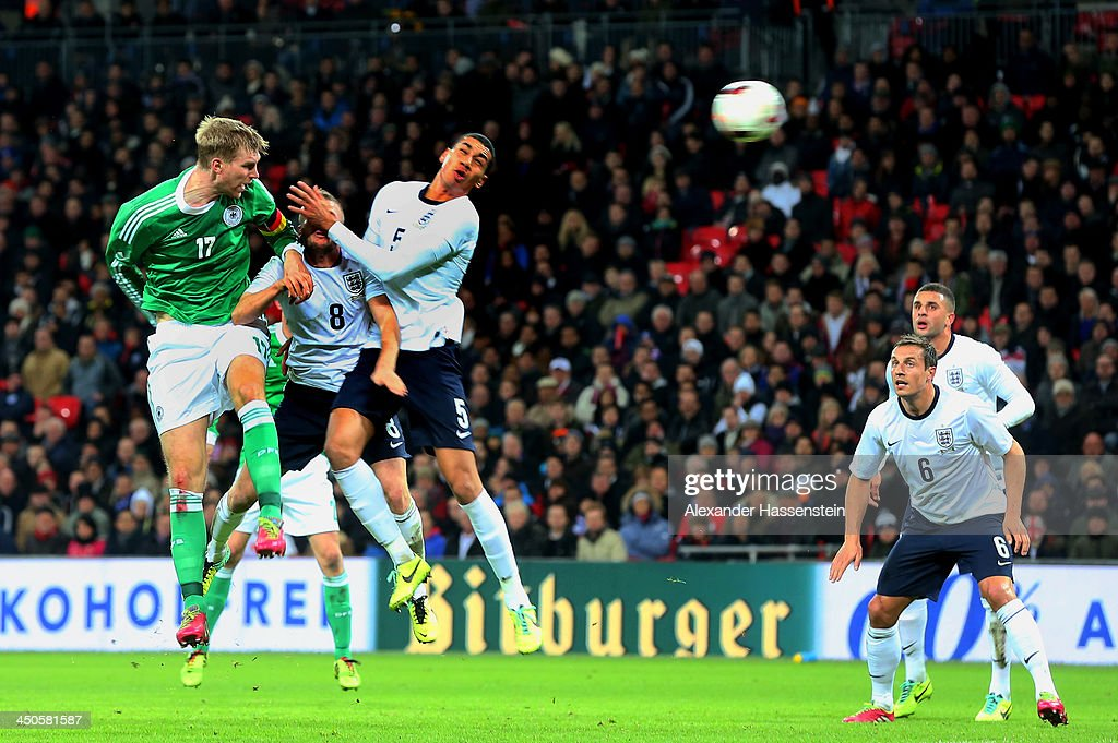 Per Mertesacker of Germany (17) scores their first goal with a header during the international friendly match between England and Germany at Wembley Stadium on November 19, 2013 in London, England.
