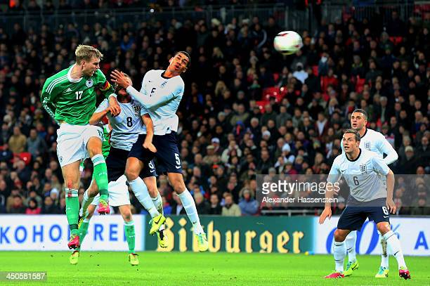 Per Mertesacker of Germany scores their first goal with a header during the international friendly match between England and Germany at Wembley...