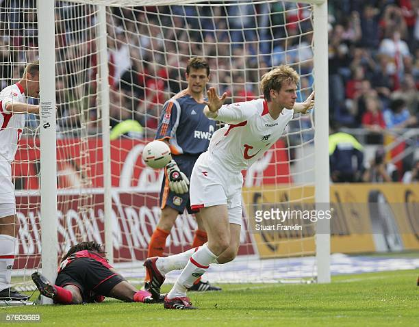Per Mertesacker of Hanover celebrates scoring his goal during the Bundesliga match between Hanover 96 and Bayer Leverkusen at the AWD Arena on May...