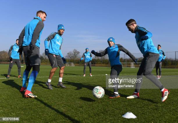 Per Mertesacker PierreEmerick Aubameyang Jack Wilshere and Aaron Ramsey of Arsenal during a training session at London Colney on February 24 2018 in...