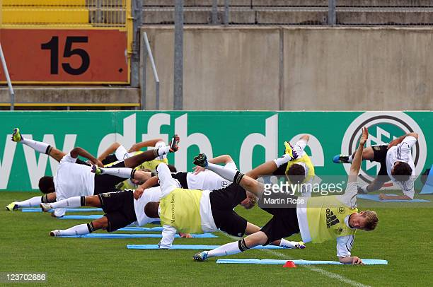 Per Mertesacker stretches during the German National team traing session at Paul Janes Stadion on September 4, 2011 in Duesseldorf, Germany.