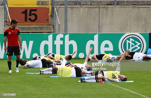 Per Mertesacker stretches during the German National team traing session at Paul Janes Stadion on September 4 2011 in Duesseldorf Germany