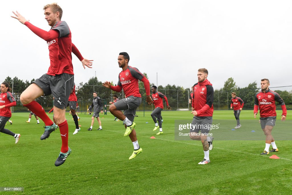 Per Mertesacker, Theo Walcott, Aaron Ramsey and Jack Wilshere of Arsenal during a training session at London Colney on September 8, 2017 in St Albans, England.