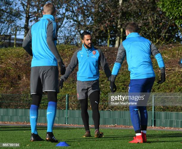 Per Mertesacker Theo Walcott and Aaron Ramsey of Arsenal during a training session at London Colney on December 9 2017 in St Albans England