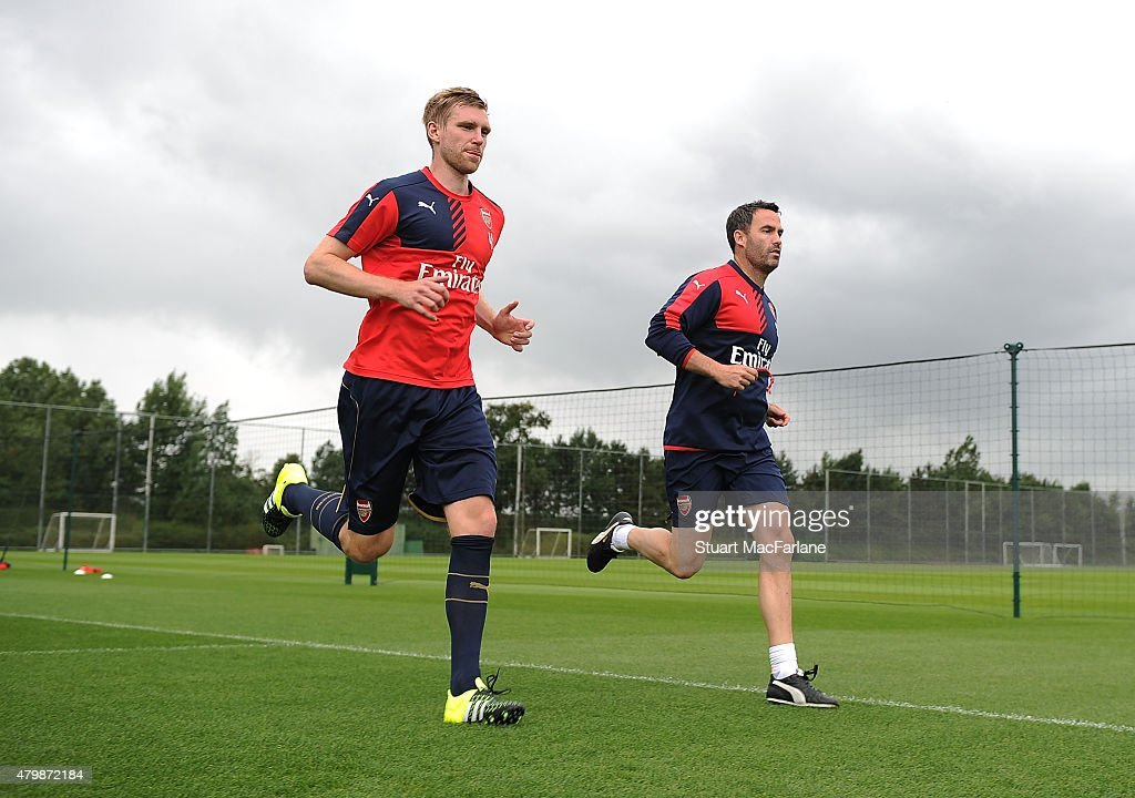 Per Mertesacker with Arsenal fitness coach Shad Forsythe during a training session at London Colney on July 8, 2015 in St Albans, England.