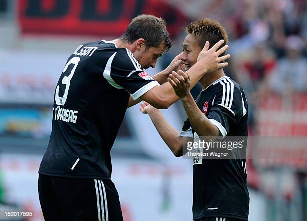 Per Nilson and his team mate Hiroshi Kiyotake of Nuernberg celebrates after winning of during the Bundesliga match between Borussia Moenchengladbach...