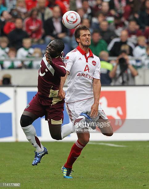 Per Nilsson of Nuernberg and Didier Ya Konan of Hannover jump for a header during the Bundesliga match between Hannover 96 and 1 FC Nuernberg at AWD...