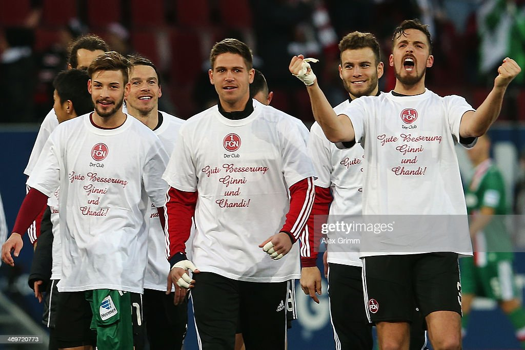 Per Nilsson (R) of Nuernberg celebrates with team mates after the Bundesliga match between FC Augsburg and 1. FC Nuernberg at SGL Arena on February 16, 2014 in Augsburg, Germany.