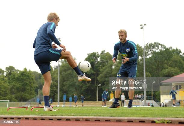 Per Skjelbred and Fabian Lustenberger of Hertha BSC during the training camp at VolksparkStadion on July 14 2018 in Neuruppin Germany
