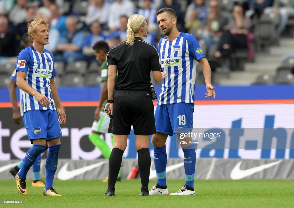 Per Skjelbred of Hertha BSC, Match referee Bibiana Steinhaus and Vedad Ibisevic of Hertha BSC during the game between Hertha BSC and Werder Bremen on September 10, 2017 in Berlin, Germany.
