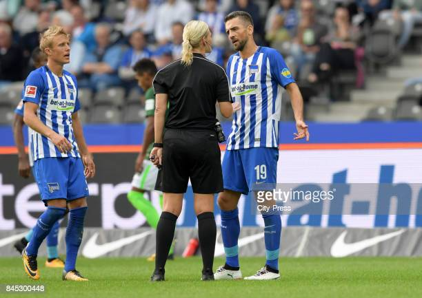 Per Skjelbred of Hertha BSC Match referee Bibiana Steinhaus and Vedad Ibisevic of Hertha BSC during the game between Hertha BSC and Werder Bremen on...