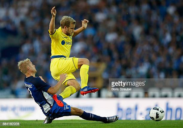 Per Skjelbred of Hertha BSC tackles Teemu Pukki of Brondby IF during the UEFA Europa League third qualifying round first leg match between Hertha BSC...