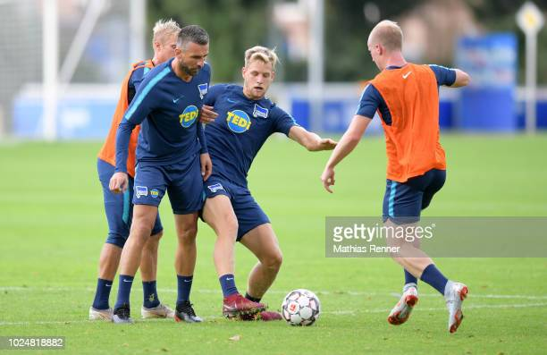 Per Skjelbred Vedad Ibisevic Arne Maier and Dennis Jastrzembski of Hertha BSC during the training at the Schenkendorfplatz on august 28 2018 in...