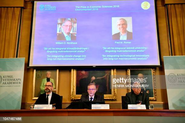 Per Stroemberg Goeran K Hansson and Per Krusell announce the laureates of the Nobel Prize in Economics during a press conference at The Royal Swedish...