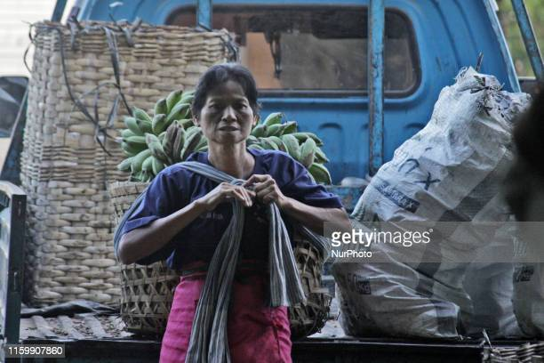 Female freight workers serve customers in Beringharjo traditional market Special Region of Yogyakarta province on Monday August 5 2019 The freight...