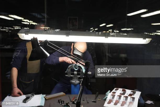 Perazzi master engraver Giuseppe Zacchi engraves the folder of a rifle on April 4 2019 at the Perazzi Armi factory in Botticino Mattina a village in...