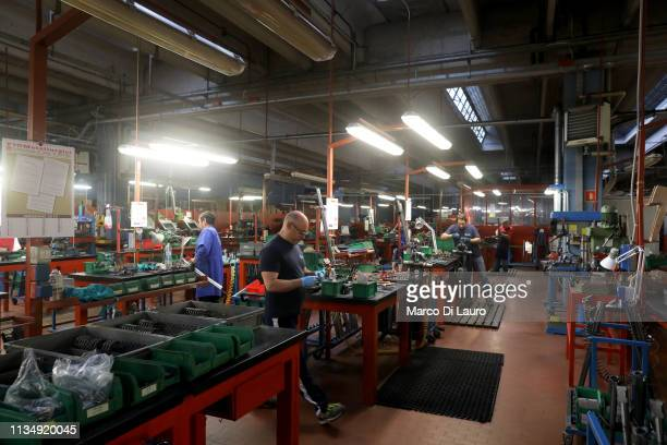 Perazzi's technicians are seen at work on April 4 2019 at the Perazzi Armi factory in Botticino Mattina a village in the outskirt of the city of...