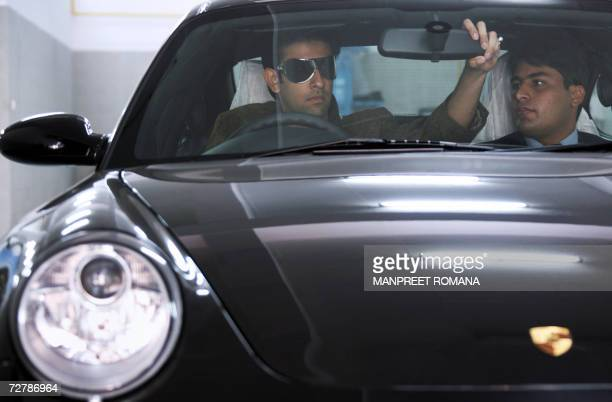 TO GO WITH INDIAECONOMYSOCIETY In this picture taken 05 December 2006 Indian businessman Rajeev Sen adjusts the rear view mirror of a Porsche Carrera...