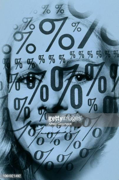 Percent signs superimposed on a smiling face of a young woman US 1993