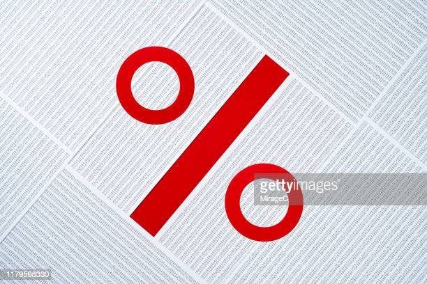 percentage sign made of data sheets pile - percentage sign stock pictures, royalty-free photos & images