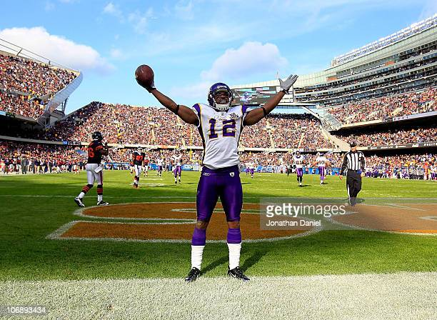 Percey Harvin of the Minnesota Vikings celebrates a touchdown catch against the Chicago Bears at Soldier Field on November 14 2010 in Chicago...
