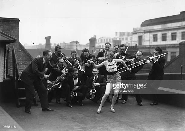 Percival Mackey's dance band pose on the roof of the London Palladium with actress Monti Ryan, Mackey's wife.