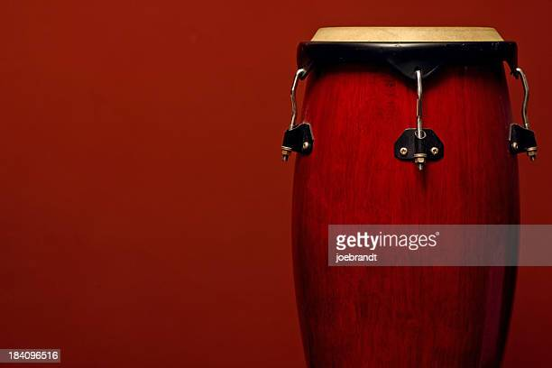 percussion instrument on red - reggae stock photos and pictures