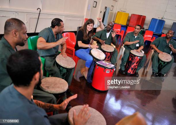 Percussionist Amy Garapic from Make Music NY leads a drum performance with inmates from Rikers Island as The National Association Of Music Merchants...